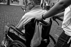 A senior sitting on wheelchair, terminal illness