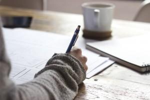 Closeup of a person filling a form, SSA