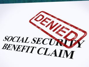 A social security benefit claim with a DENIED stamp